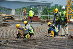 Construction workers fabricating floor slab reinforcement bar Stock Photo