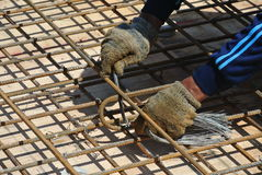 Construction workers fabricating floor slab reinforcement bar Stock Photos