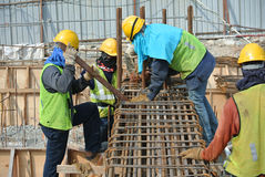Construction workers fabricating ground beam reinforcement bar Royalty Free Stock Photos