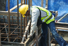 A construction workers fabricating pile cap formwork Royalty Free Stock Image