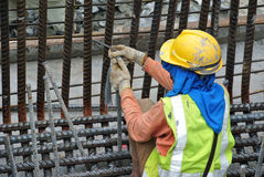 Construction workers fabricating pile cap steel reinforcement bar Royalty Free Stock Photography