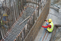 Construction workers fabricating pile cap steel reinforcement bar Stock Photos