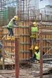 Construction workers fabricating reinforcement concrete wall form work Stock Images