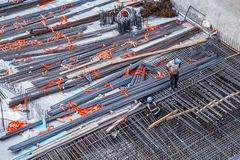 Construction workers fabricating steel reinforcement bar at the construction site stock photos