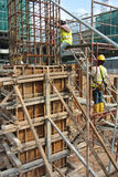 Construction workers fabricating timber column formwork at the construction site Stock Photography