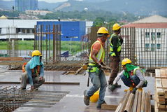 Construction workers fabricating timber form work Royalty Free Stock Photo