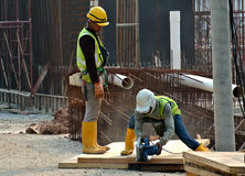 Construction workers fabricating timber form work Royalty Free Stock Image