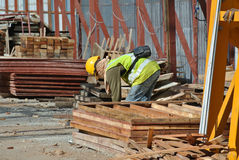 Construction workers fabricating timber form work Stock Photo