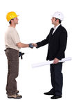 Construction workers greeting Royalty Free Stock Image