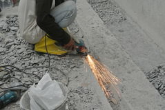 Construction workers grinding metal surface Stock Images