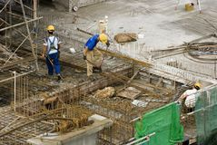 Construction workers at high-rise building Stock Photo