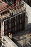 Construction workers at high-rise building Royalty Free Stock Photos