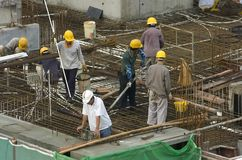 Construction workers at high-rise building Stock Images