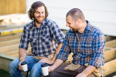 Construction Workers Holding Disposable Coffee royalty free stock image