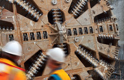 Construction workers huge tunnel machine Stock Photo