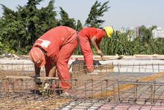 Construction Workers Install Rebar Stock Images