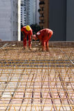 Construction Workers Install Rebar - Vertical Royalty Free Stock Photography