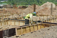 Construction workers installing ground beam formwork Stock Images