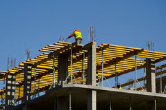 Construction workers installing mounting horizontal formwork on the building construction site. Stock Image