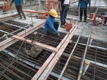 Construction workers are installing steel rods in reinforced concrete post tension site concrete steel. Construction workers are installing steel rods in royalty free stock photo
