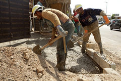 Construction workers, Lebanon. Construction workers mixing cement, Lebanon Royalty Free Stock Photography