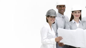 Construction workers looking at a drawing  in a building Stock Image
