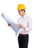 Construction workers looking at layout drawing Royalty Free Stock Image