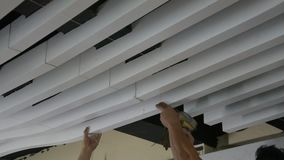 Construction workers make the ceiling whiite lath stock video footage