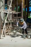 Construction workers mixing mortar Stock Photos
