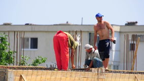 Construction workers new building home site team stock video