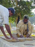 Construction Workers in Pakistan. Construction workers are making bricks floor, in Karachi,Pakistan Royalty Free Stock Images
