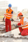 Construction workers paving street Royalty Free Stock Photos