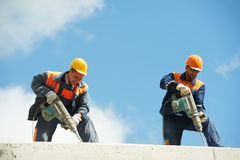 Construction workers with perforator Royalty Free Stock Images