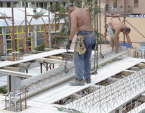 Construction workers placing the concrete beams Stock Photography
