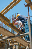 Construction workers placing formwork beams royalty free stock image