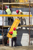 Construction workers placing formworks Stock Photography