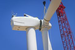 Workmen prepare a large rotor assembly for wind turbine Stock Images
