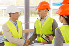 Construction workers. Project discussion Stock Image
