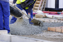 Construction workers pumping Royalty Free Stock Photography