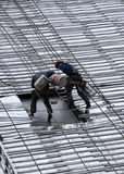 Workers rappel down the face of a building. Stock Photography