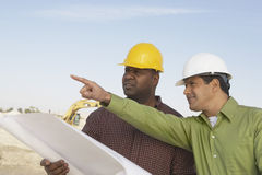 Construction Workers Reading Blueprints Stock Images