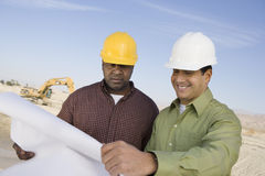 Construction Workers Reading Blueprints Royalty Free Stock Photos