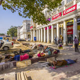 Construction workers relax at Connaught place Stock Photo