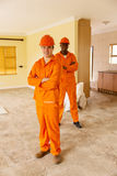 Construction workers renovating Stock Photo