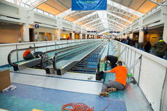Construction Workers Repair People Mover stock image