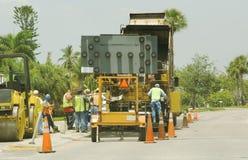 Construction workers repairing. Broken road Stock Photos