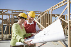 Construction Workers Reviewing Blueprint Stock Image
