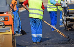 Construction workers at the road construction Royalty Free Stock Photo