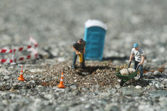 Construction Workers on the Road. Miniature Construction Workers on the Road Royalty Free Stock Images
