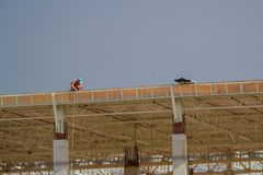 Construction workers on the roof of the building Stock Image